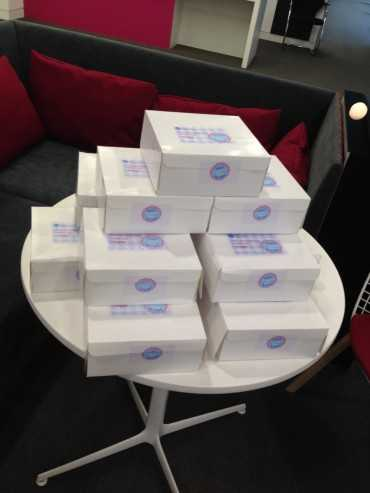 pile of cream tea boxes on a table