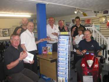 Mobility shop workers enjoing their cream teas