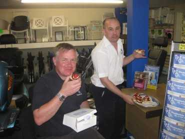 2 men enjoying their scones